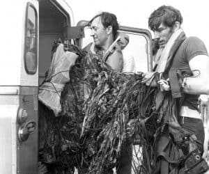 Stan Shout and John English after a water jump into the sea. circa 1972